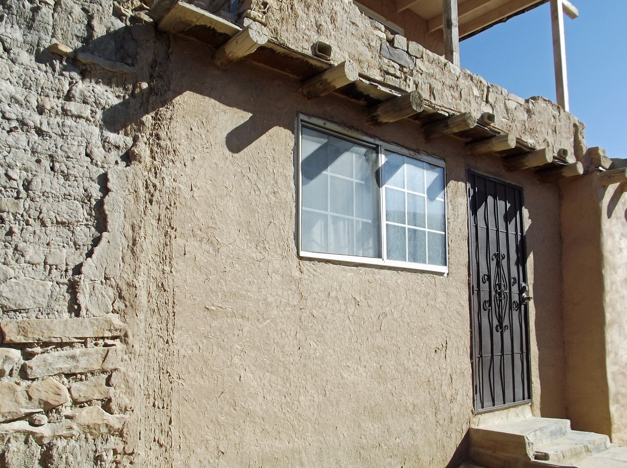 Adobe house with window and door