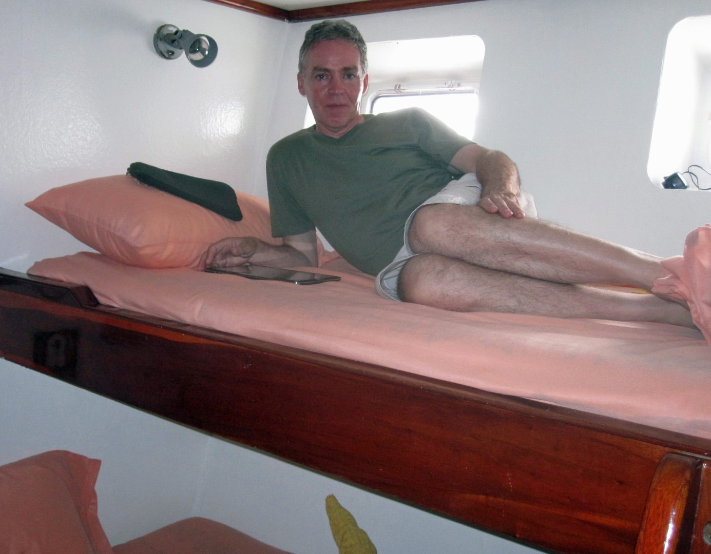 Man relaxing on a bunk bed