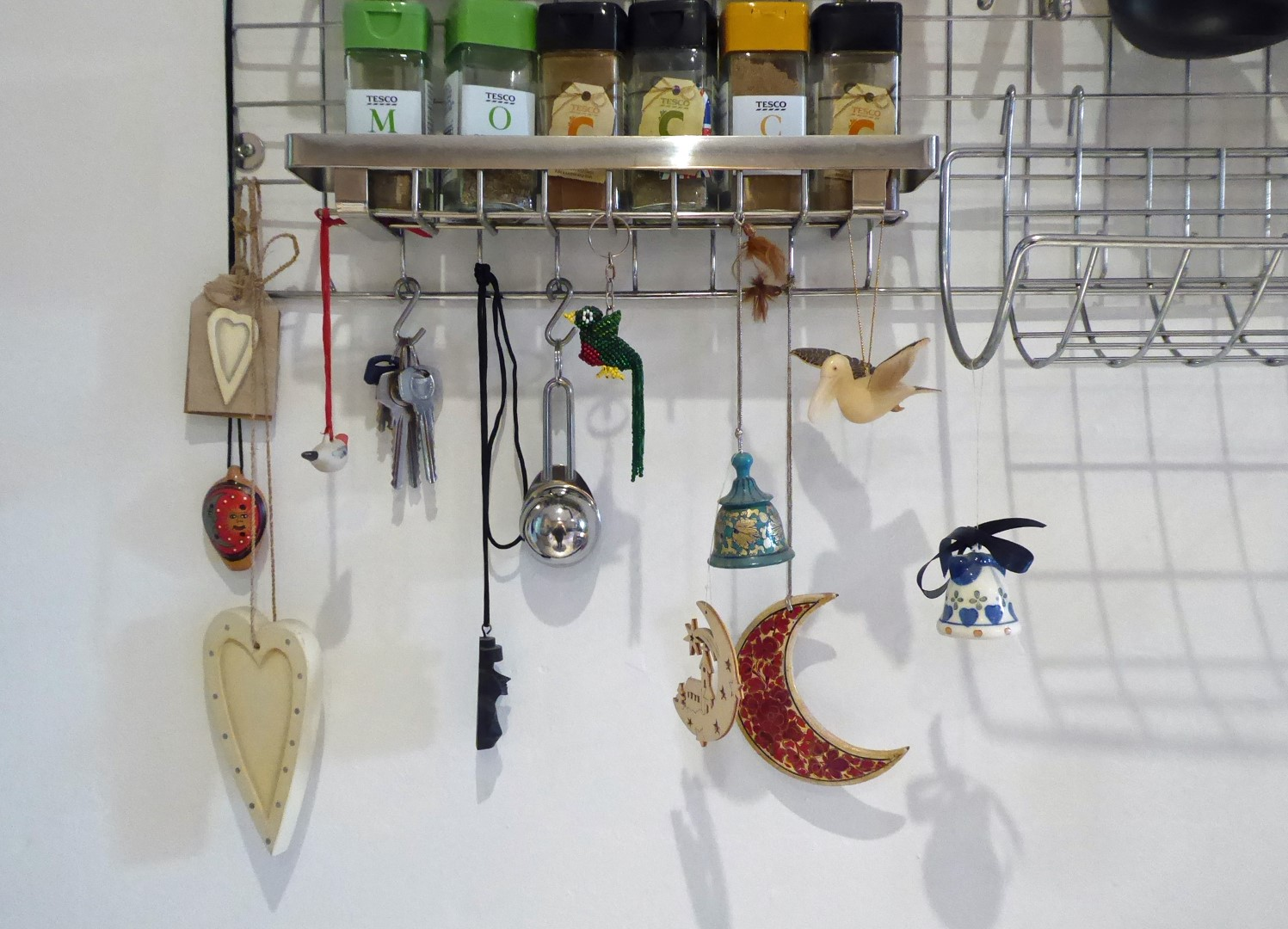 Small decorations hanging from a metal rack