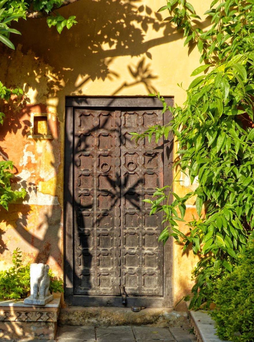 Wooden door in yellow wall