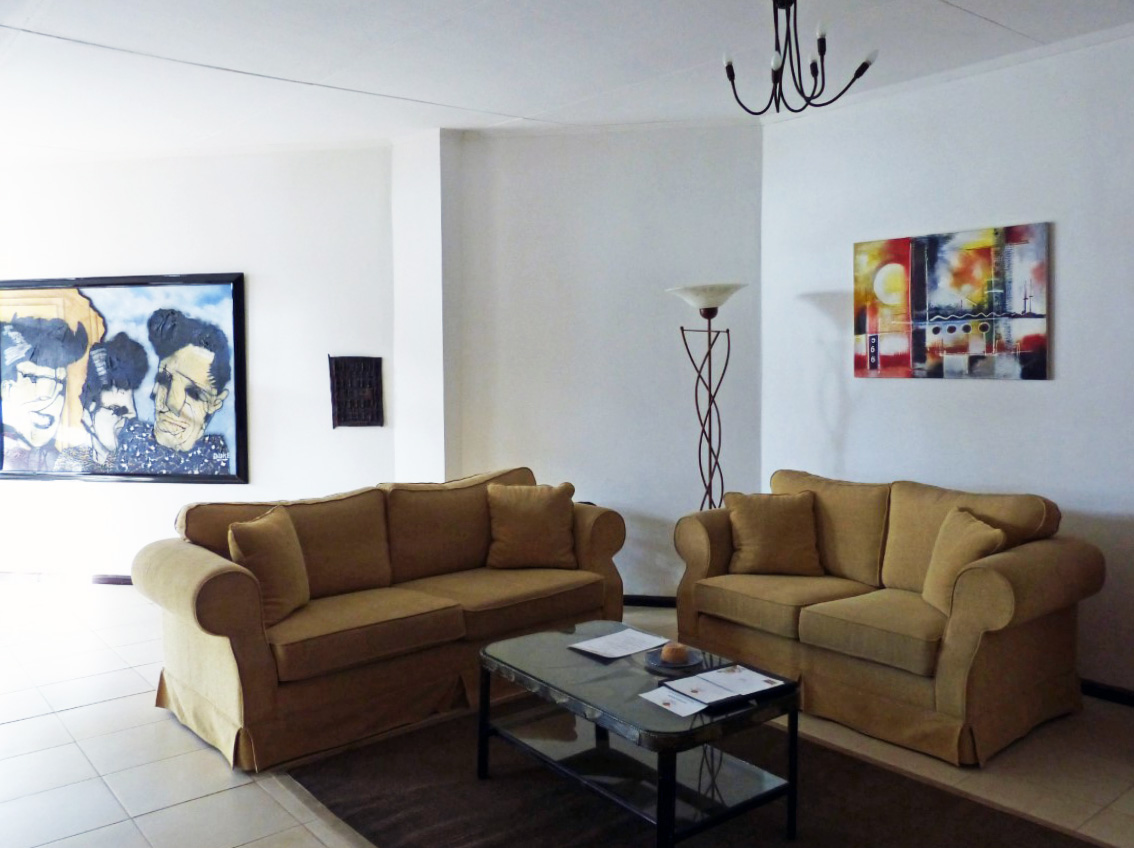 Two sofas, coffee table and modern art on the walls