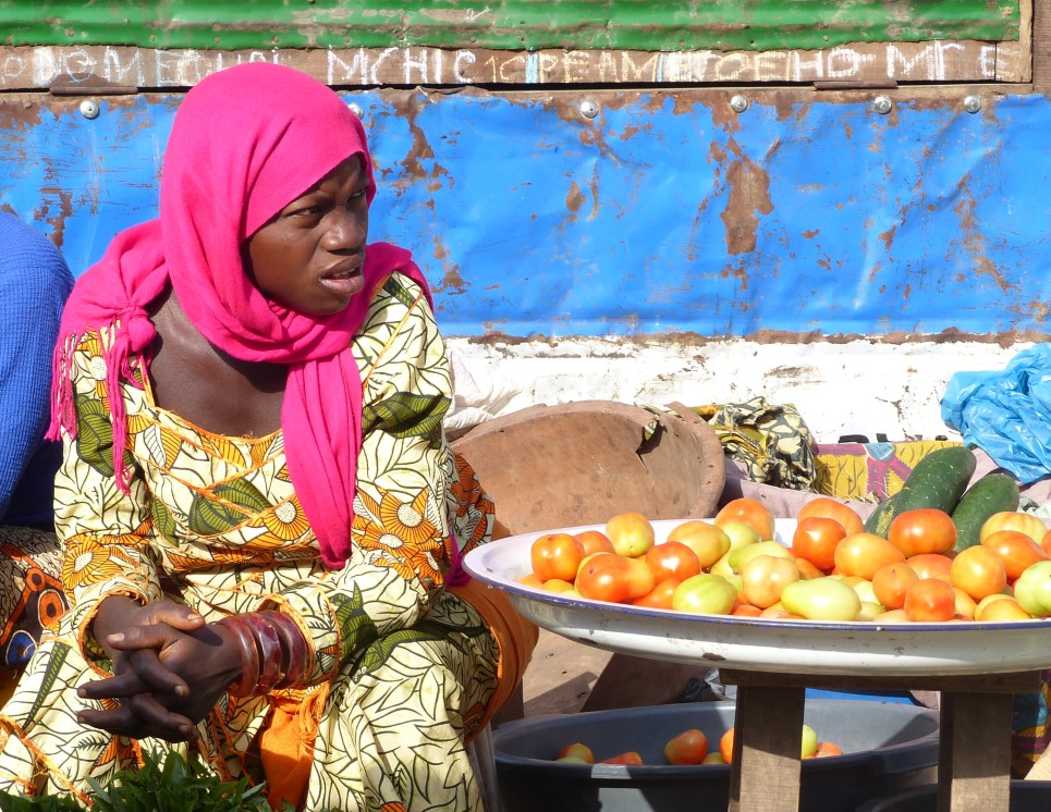 Woman selling tomatoes at an African market