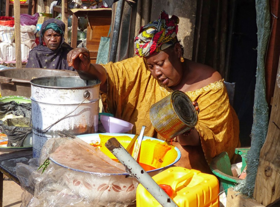 Woman in bright yellow at an African market