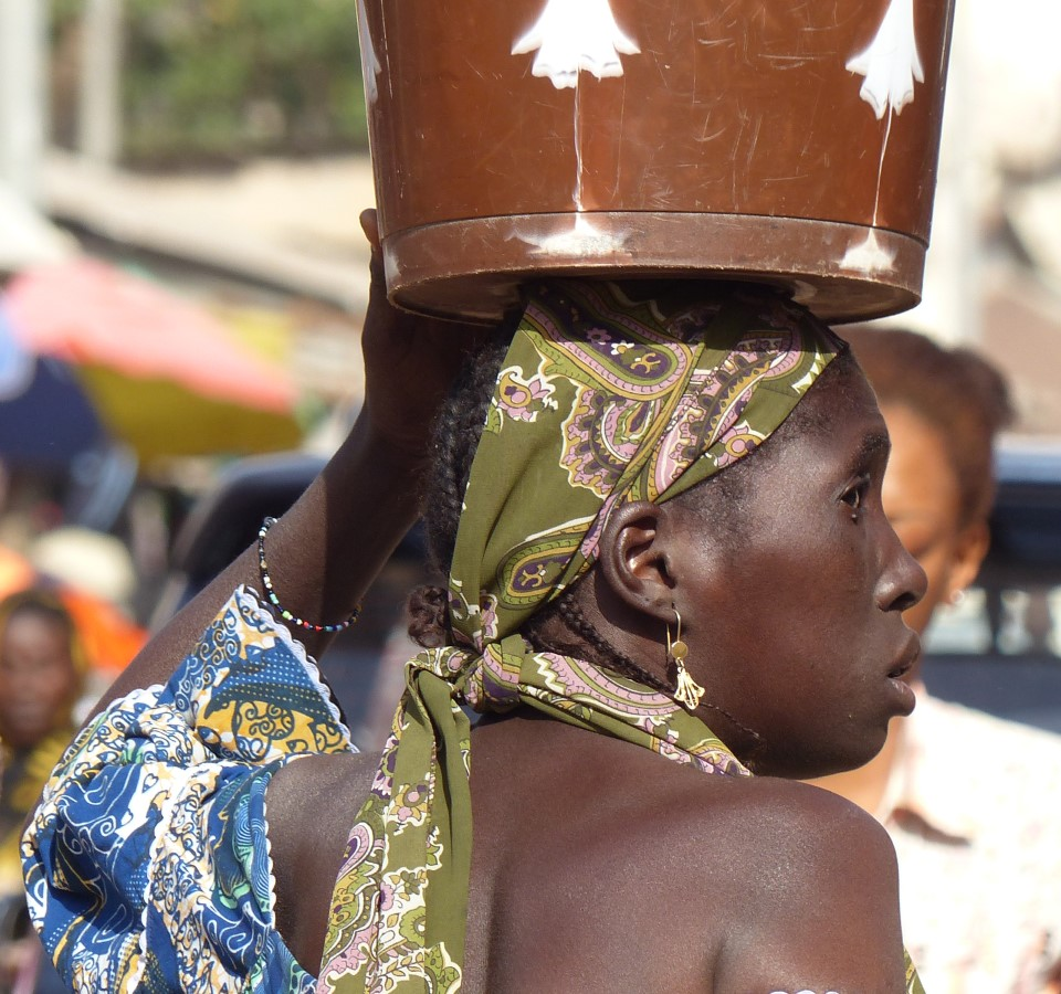 Woman with tin on her head