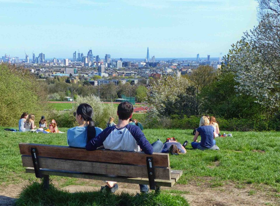 City view with people on bench in foreground