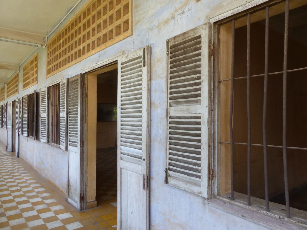 Corridor with checked floor and barred windows