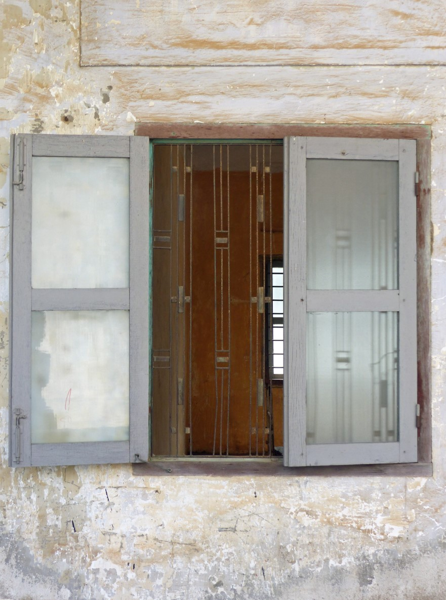 Barred window with shutters