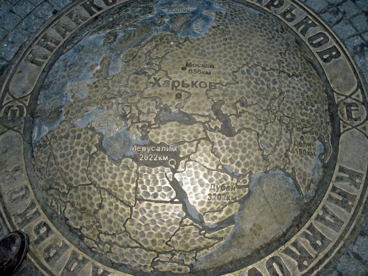 Bronze map of the world with Cyrillic lettering