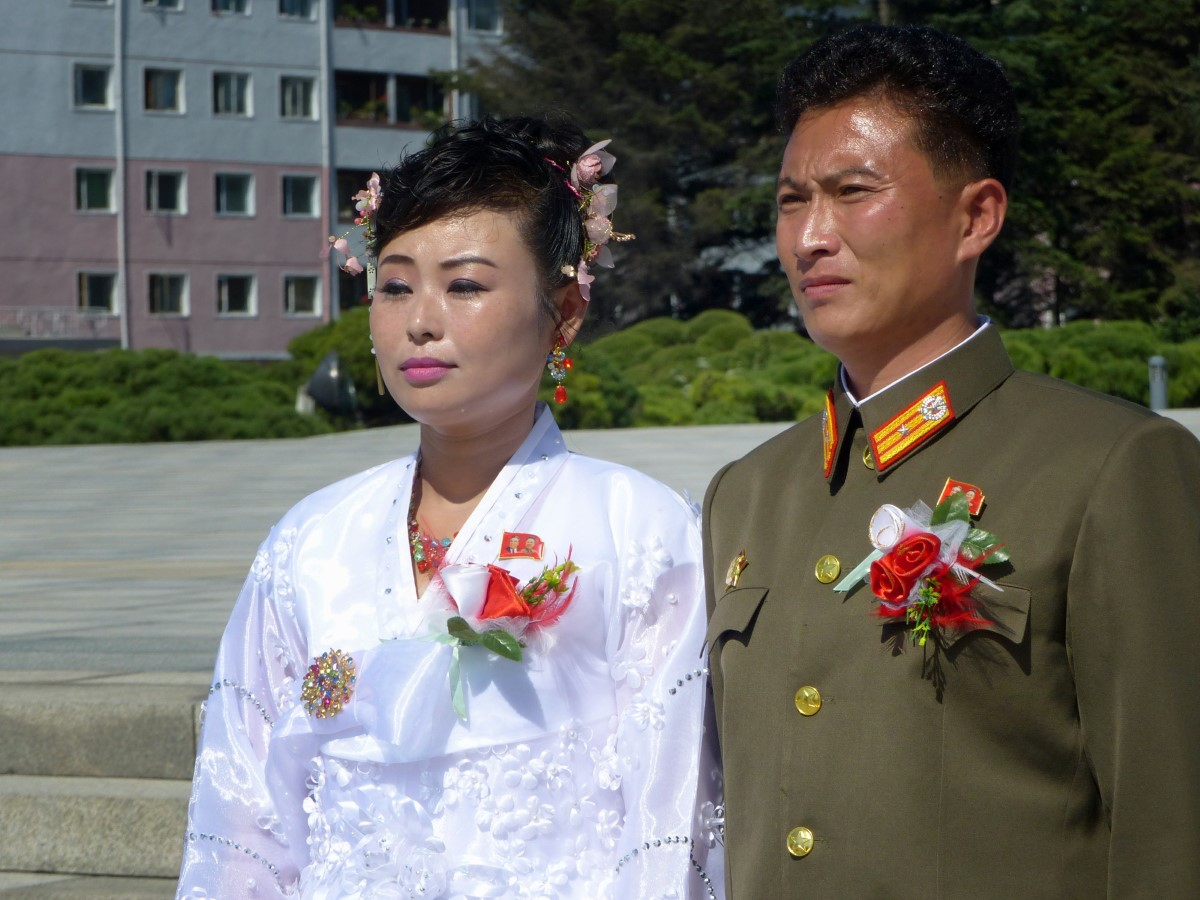 Lady in traditional dress and man in military uniform