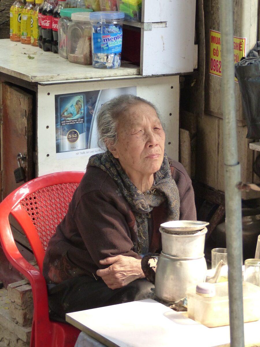 Elderly lady in a basic shop