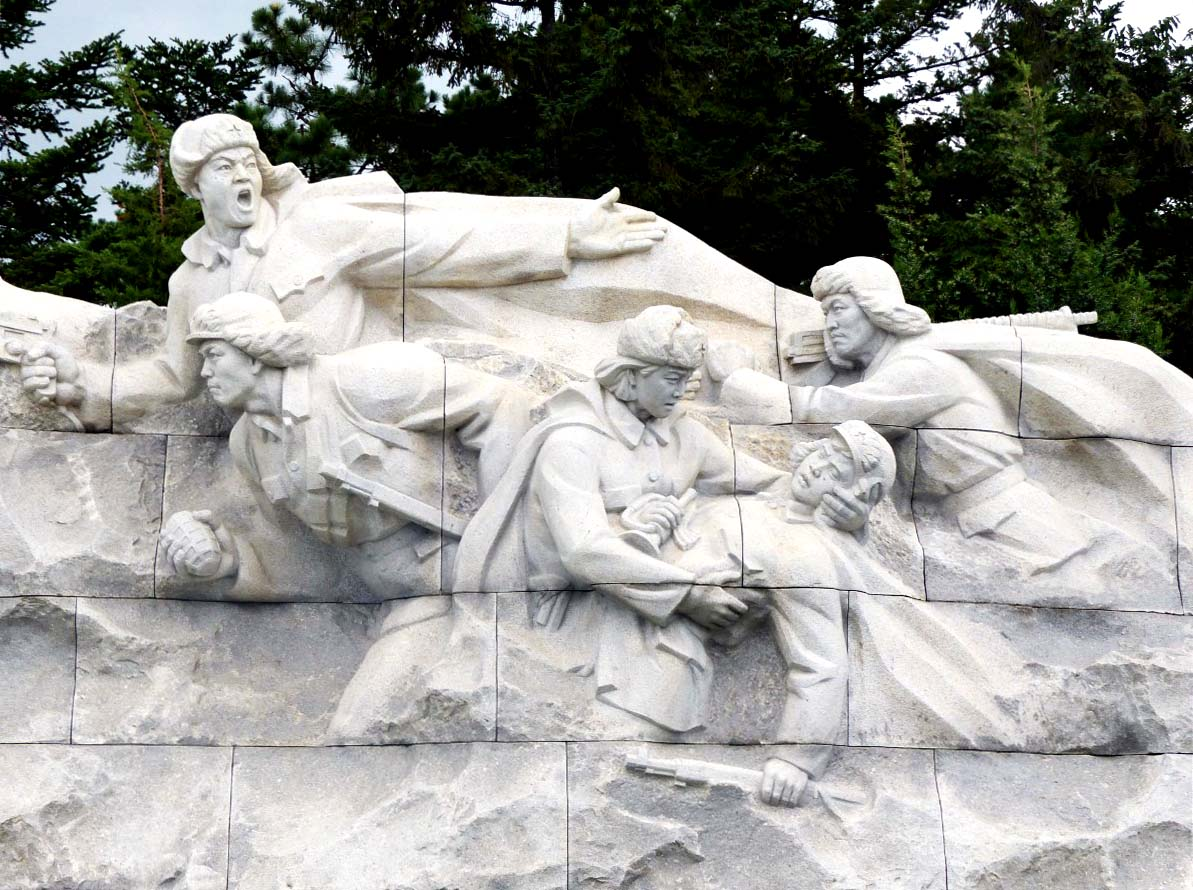 Huge stone figures of wounded revolutionary and companions