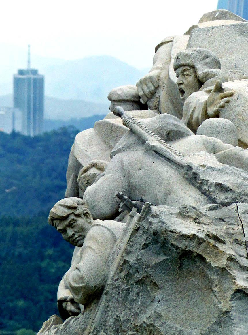 Huge stone figures overlooking a city