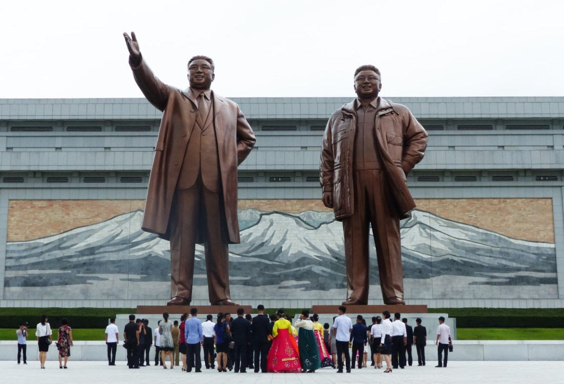 Large statues of North Korean Leaders with visiting locals