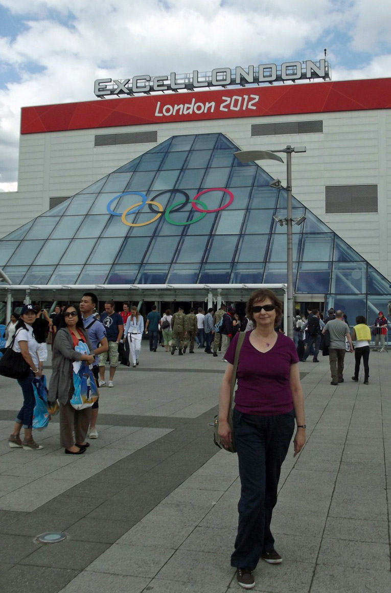 Woman standing in front of sports venue