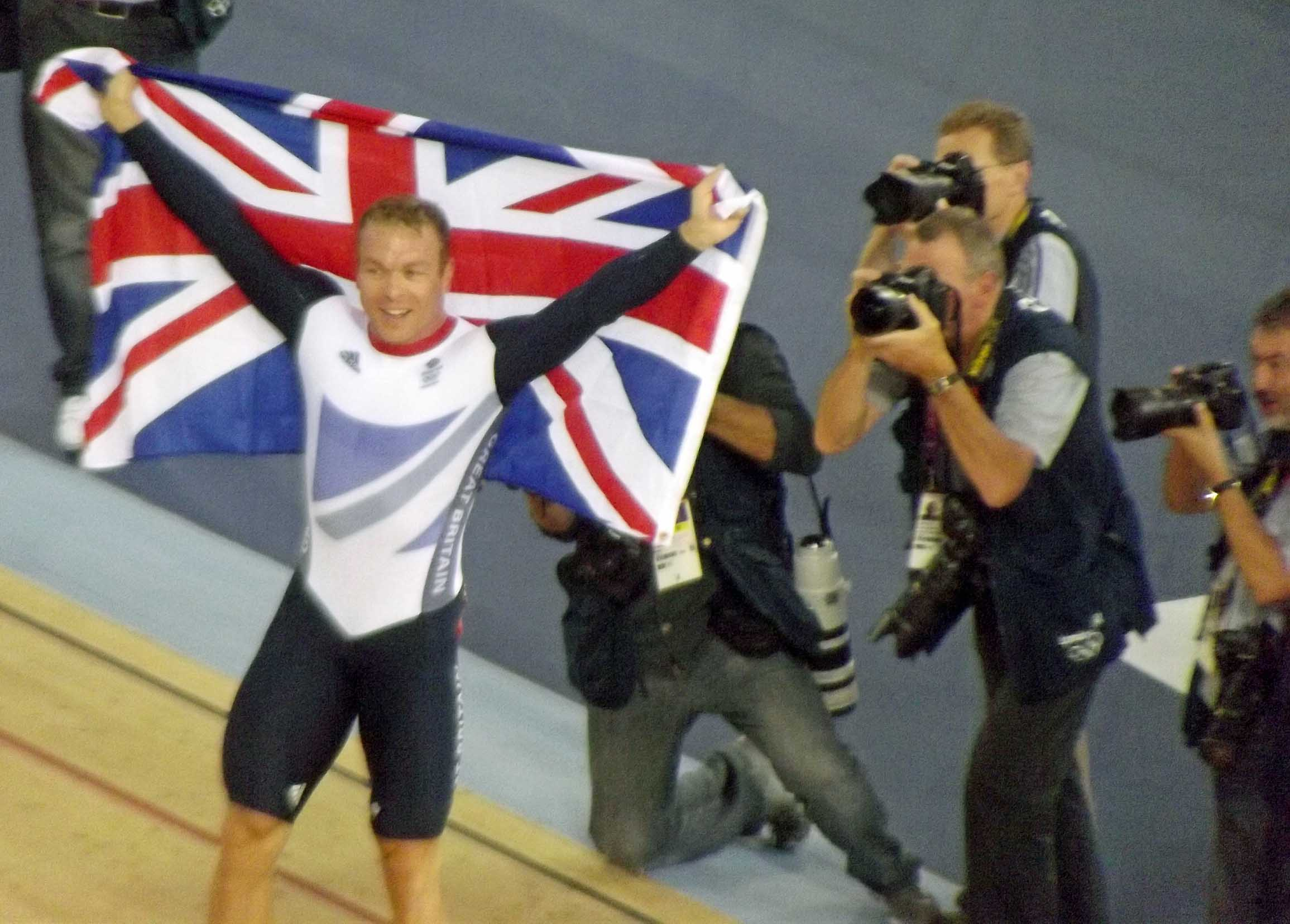 Man in lycra holding Union Jack flag