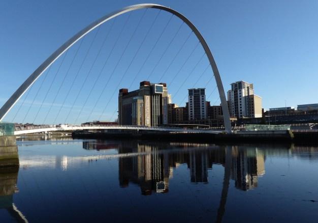 Modern bridge over a river in sunshine