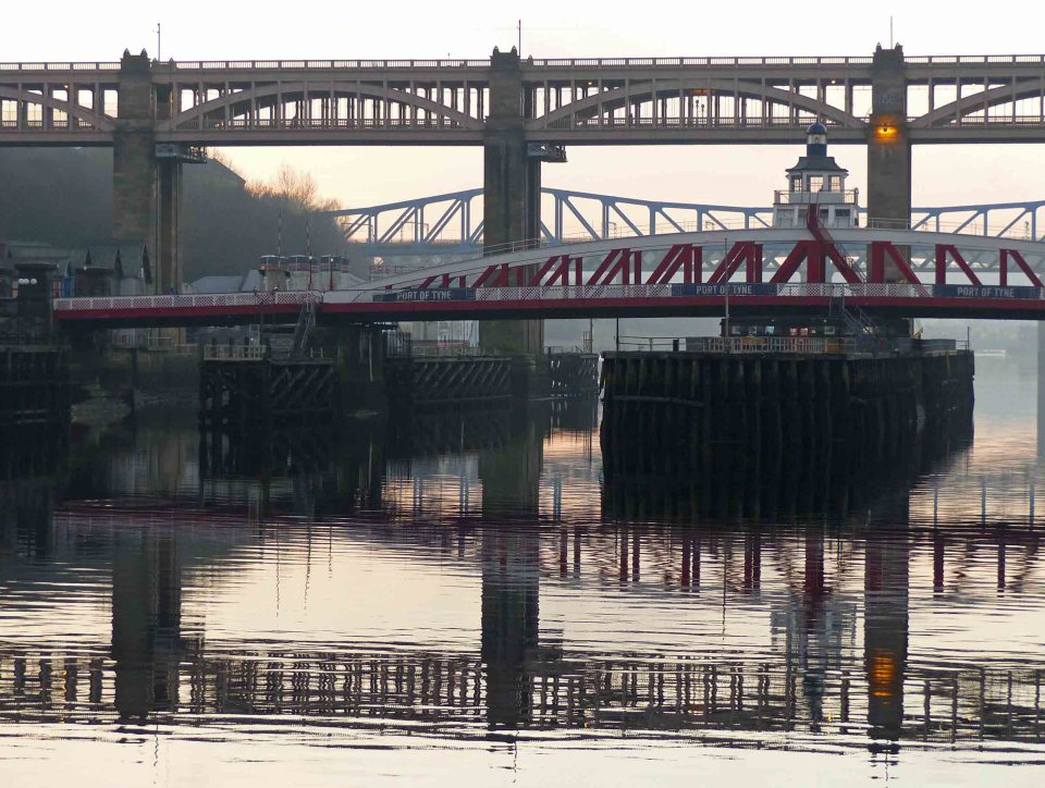 Three bridges and river reflections