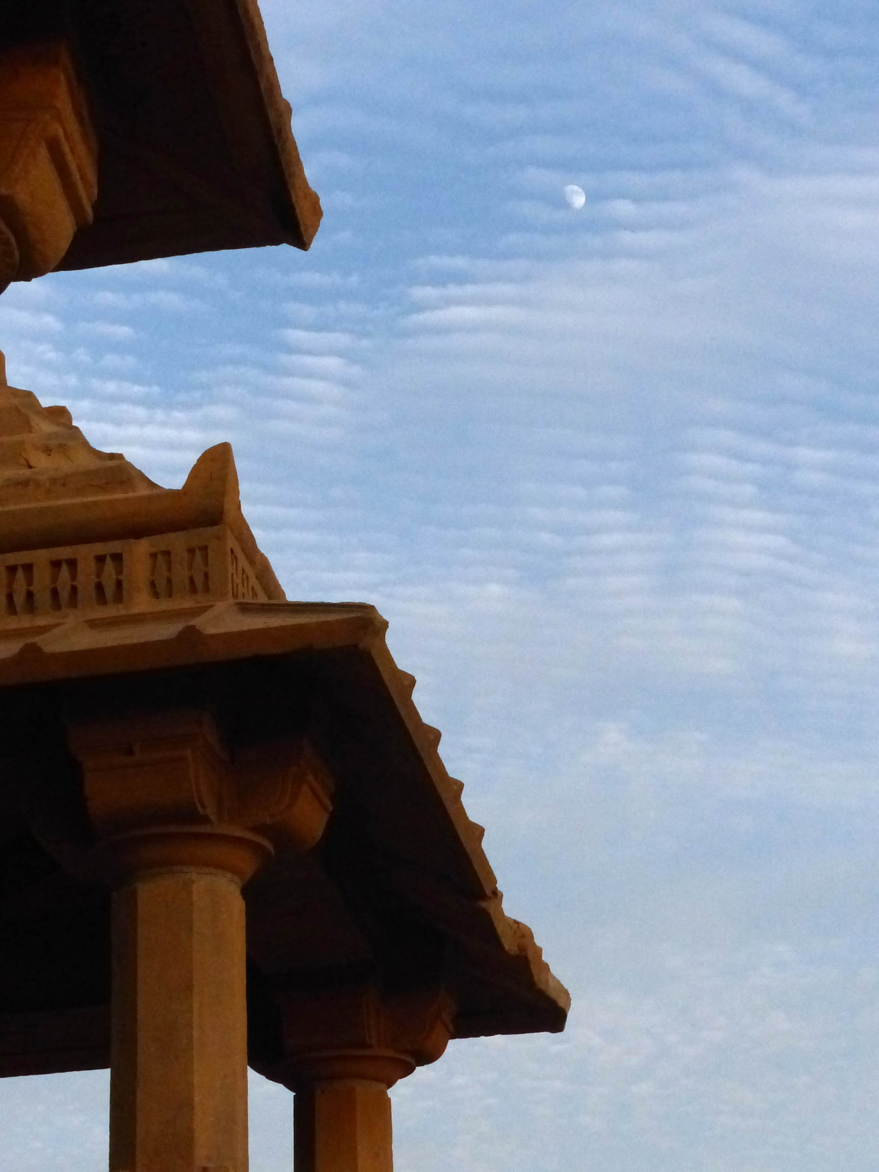 Moon over an old portico