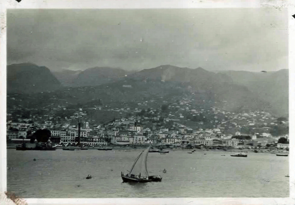 Old photo of town and mountains from the sea