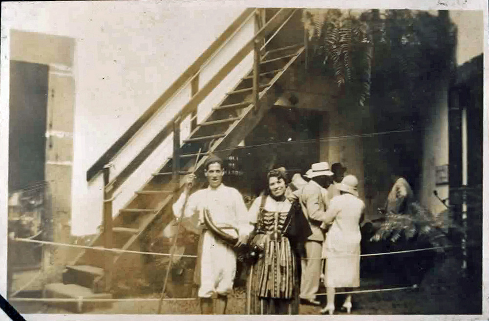 Old photo of people posing in traditional costume
