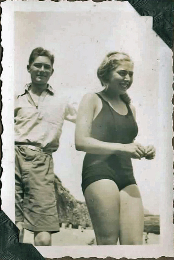 Old photo of couple on a beach