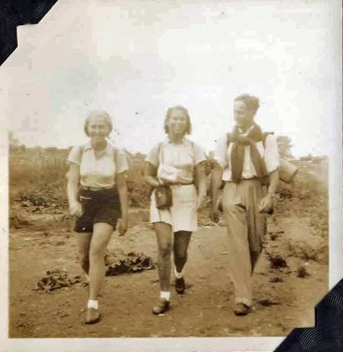 Old photo of three people walking