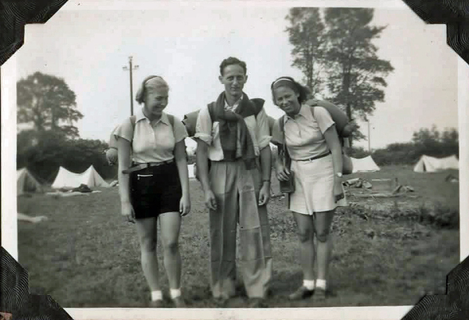 Old photo of three people with rucksacks