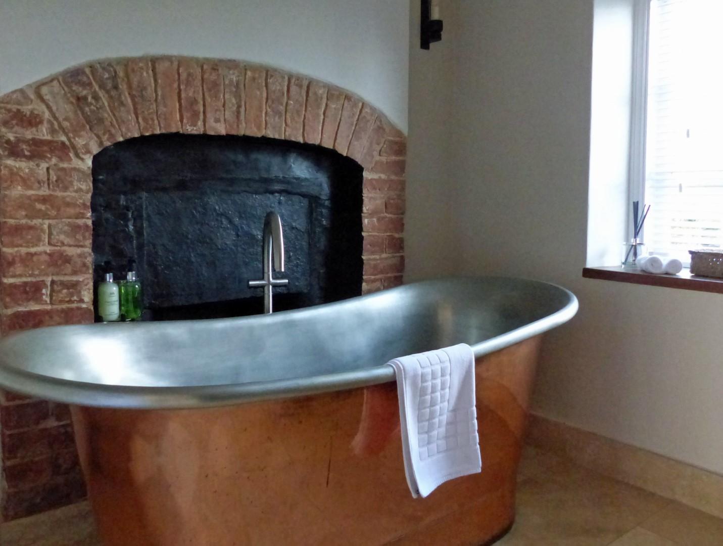 Large copper bath tub