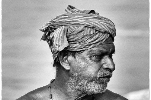Black and white photo of a man in a turban