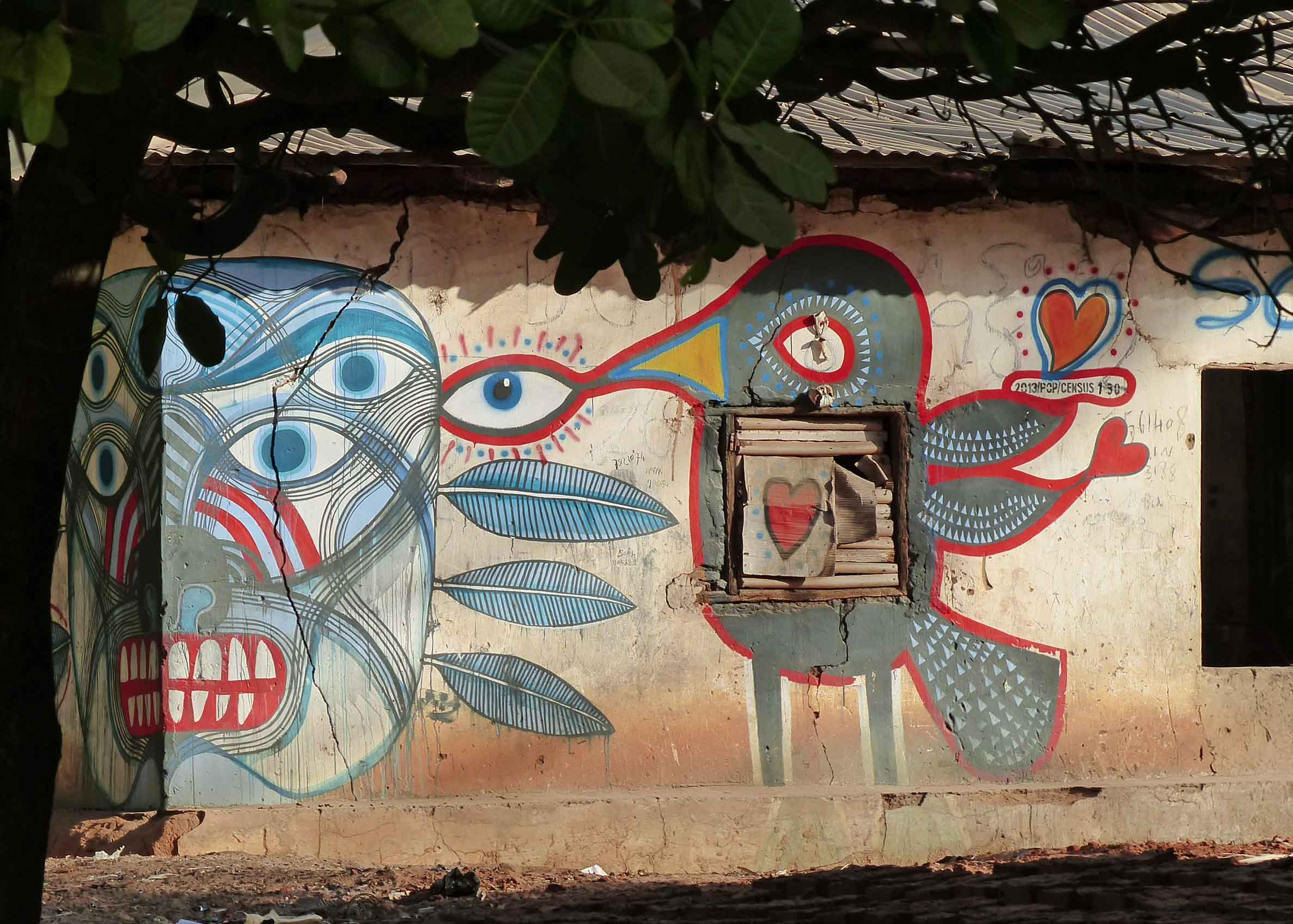 Colourful mural on house with metal roof