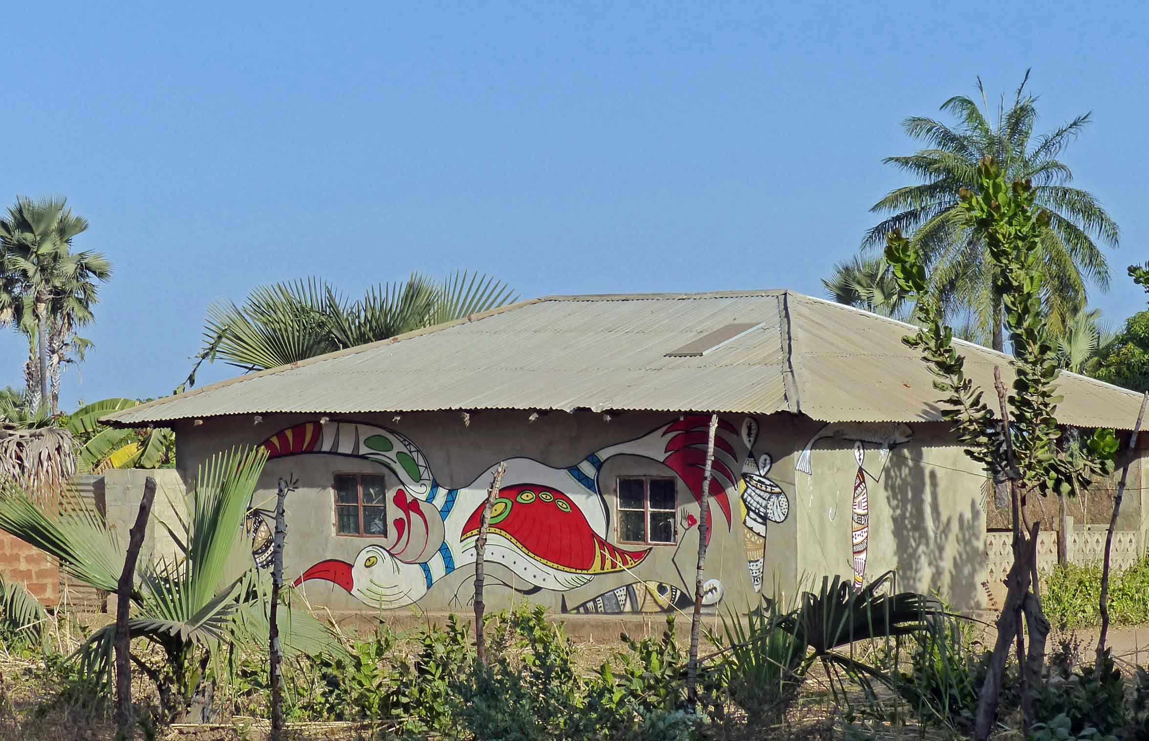 Colourfully painted house with iron roof