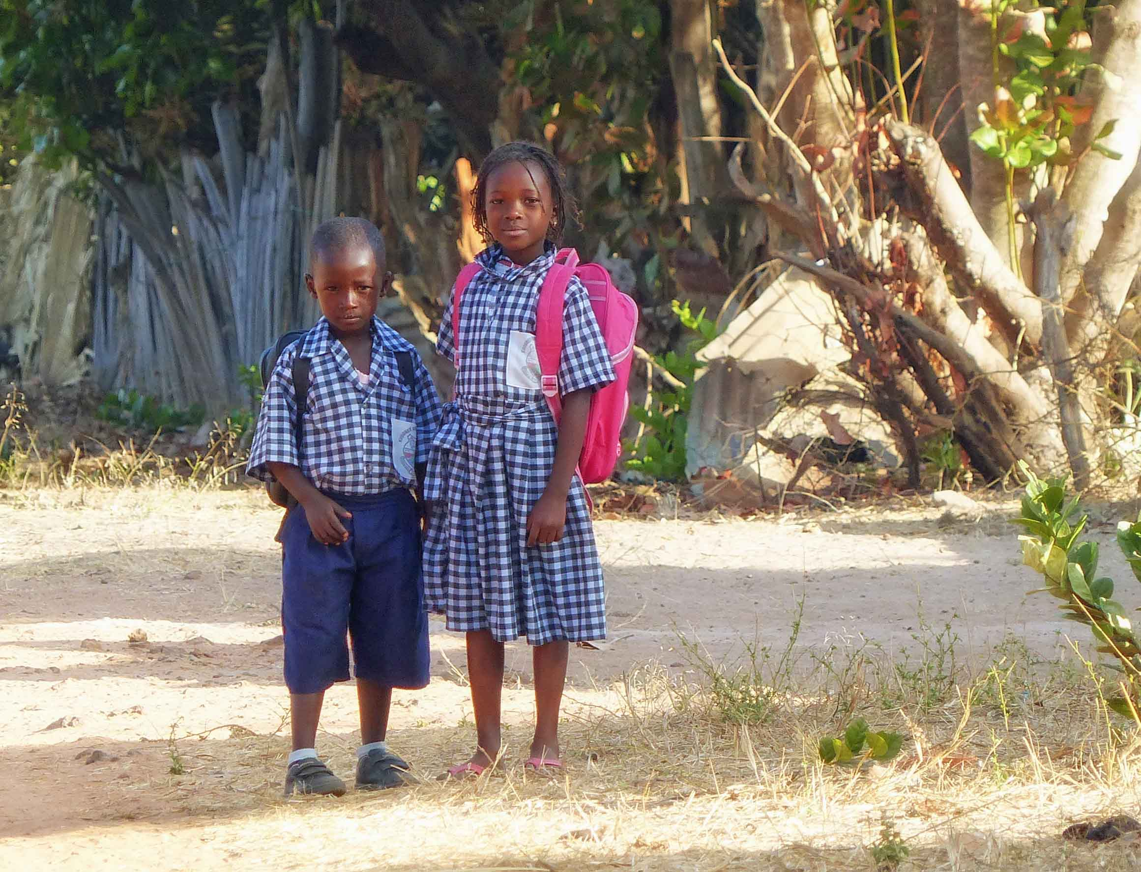 Boy and girl in blue checked uniform
