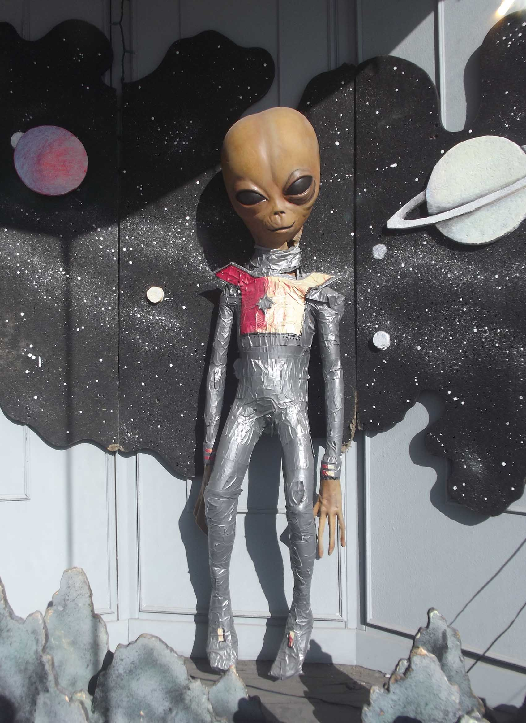Alien model in spacesuit