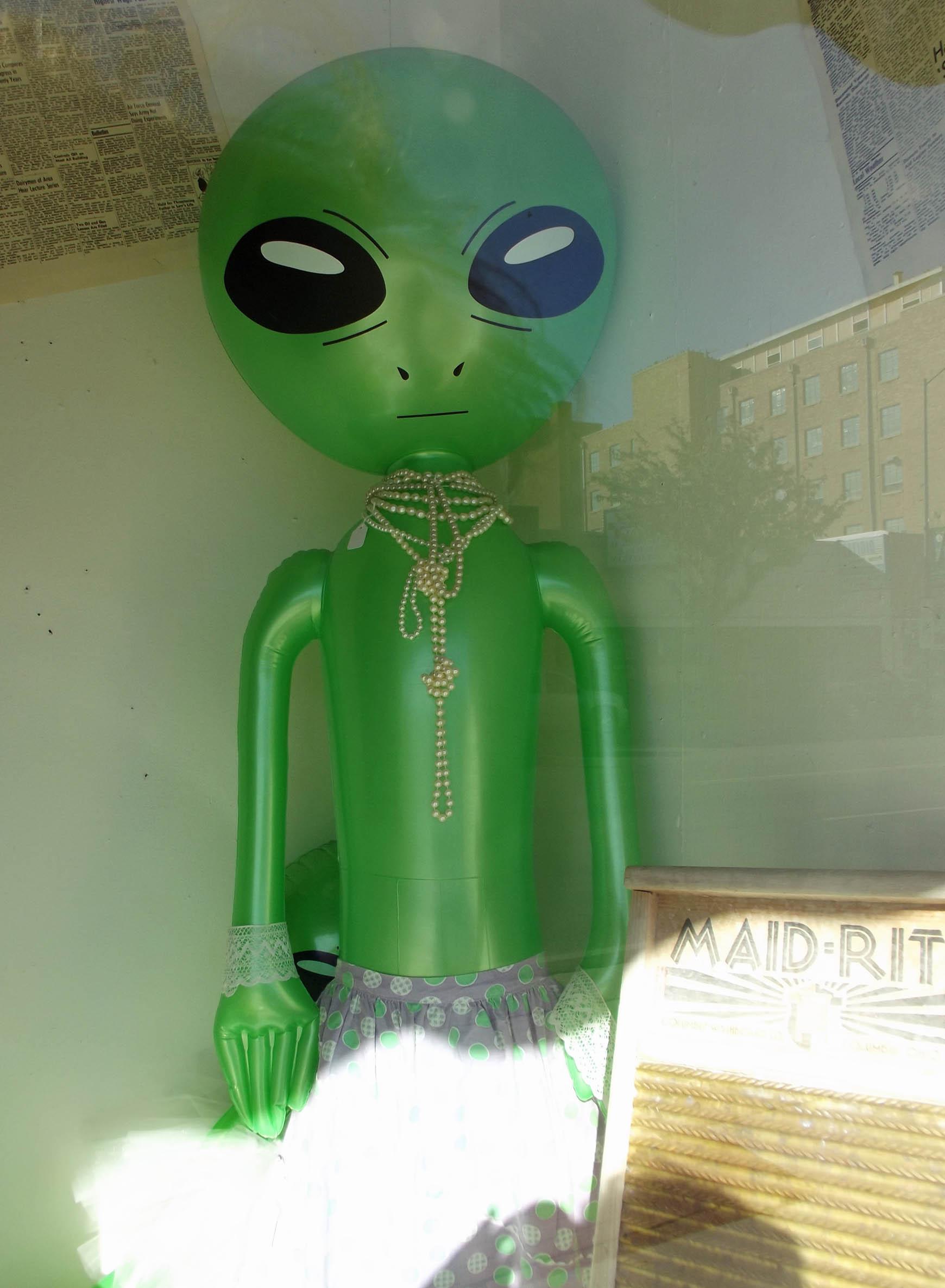 Green inflatable alien