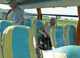 Two people taking a seat on a bus