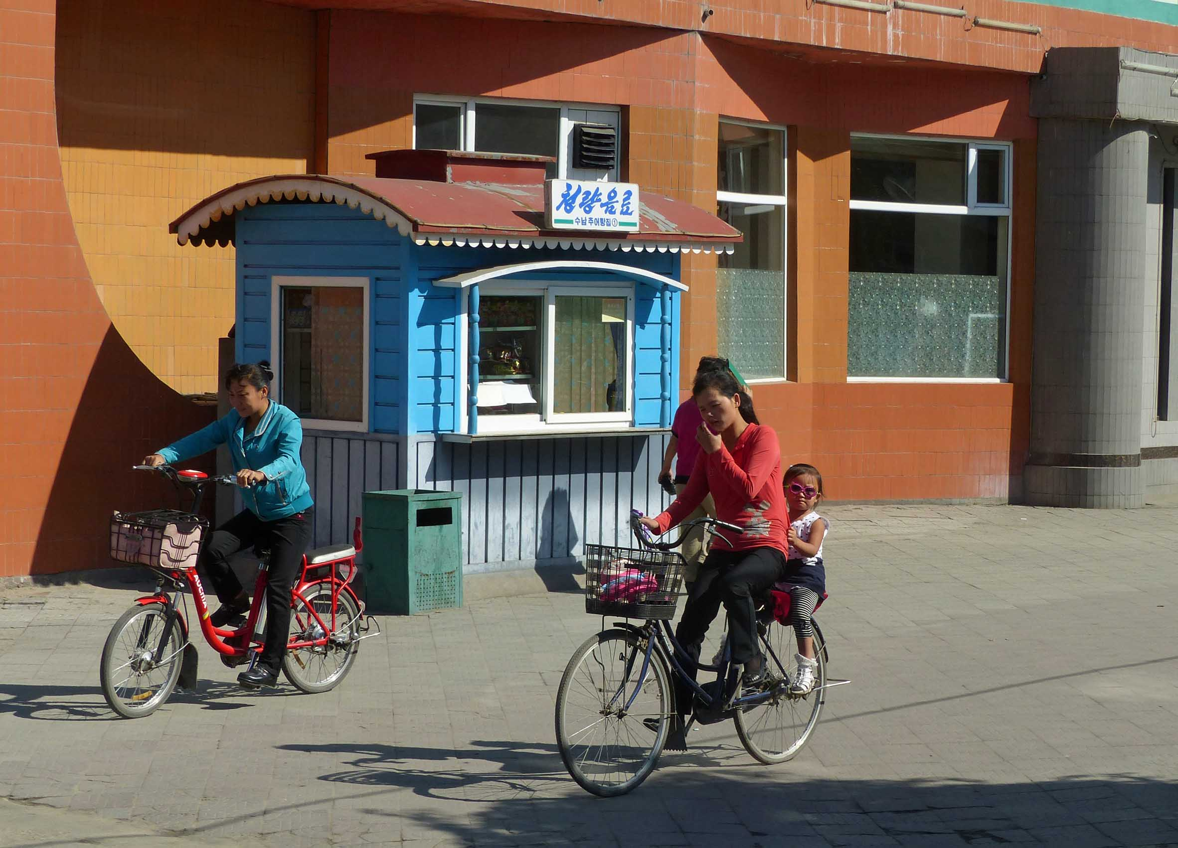 Lady on a bike with small child