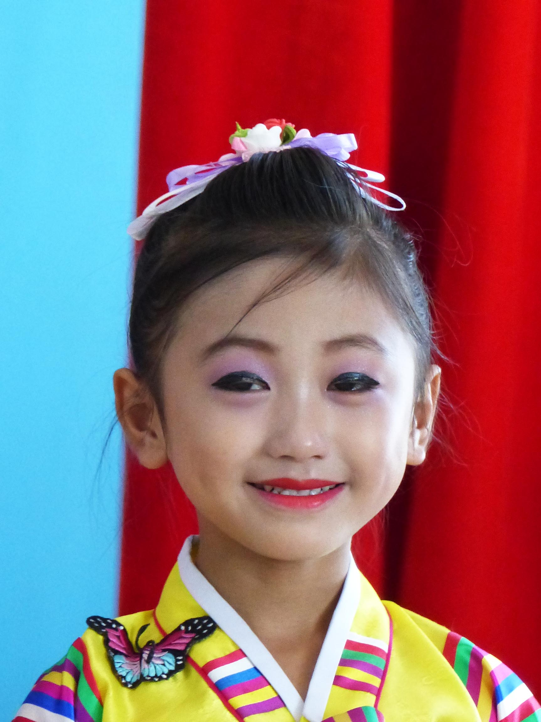 Young girl in traditional dress with make-up