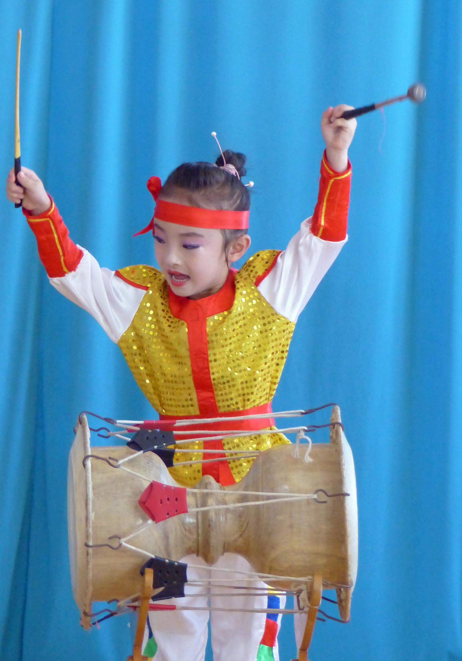 Young girl drumming