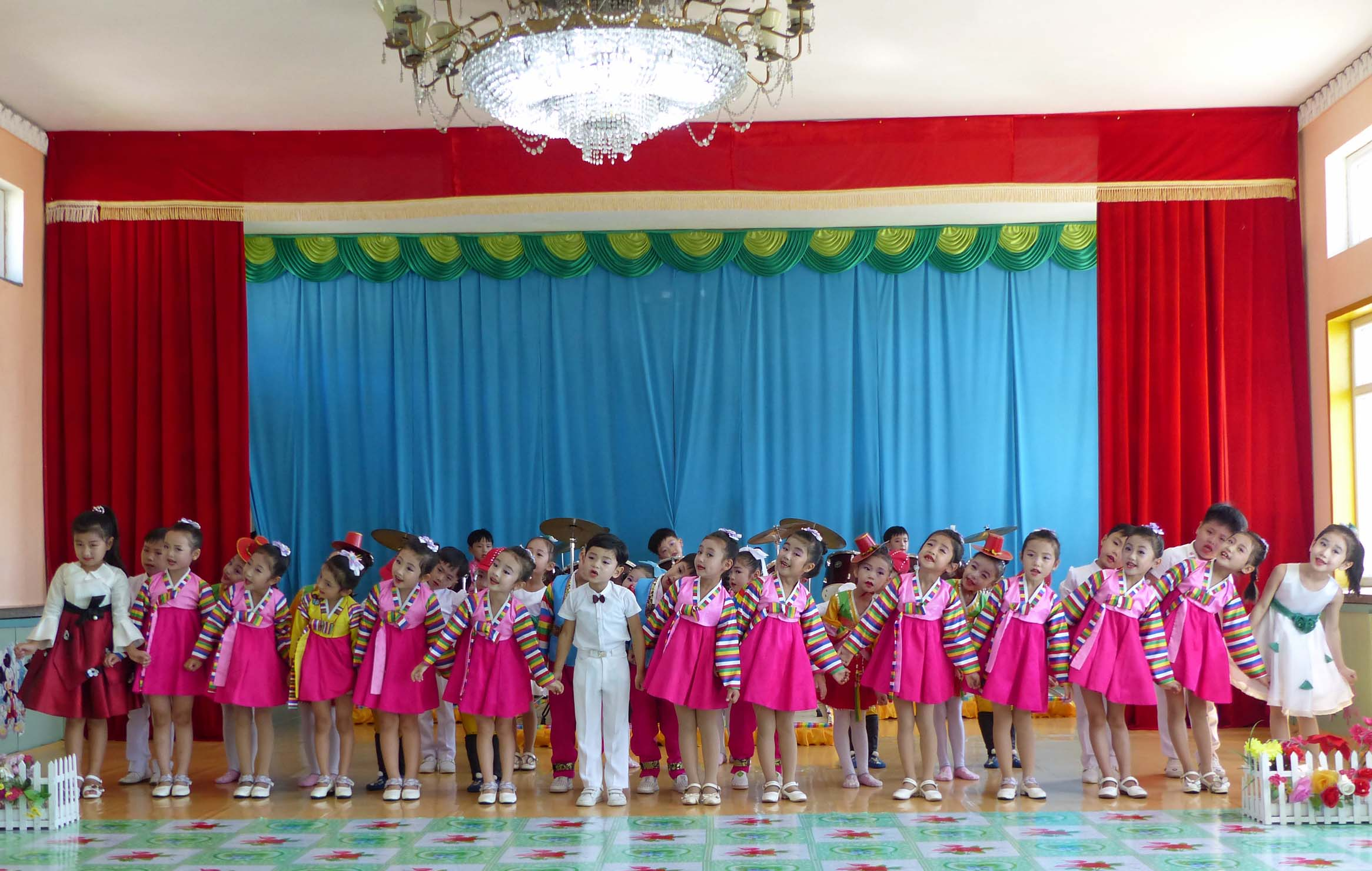 Young girls and boys in traditional dress