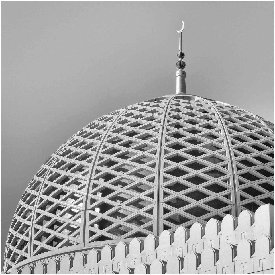 Black and white photo of modern dome with crescent moon at the top