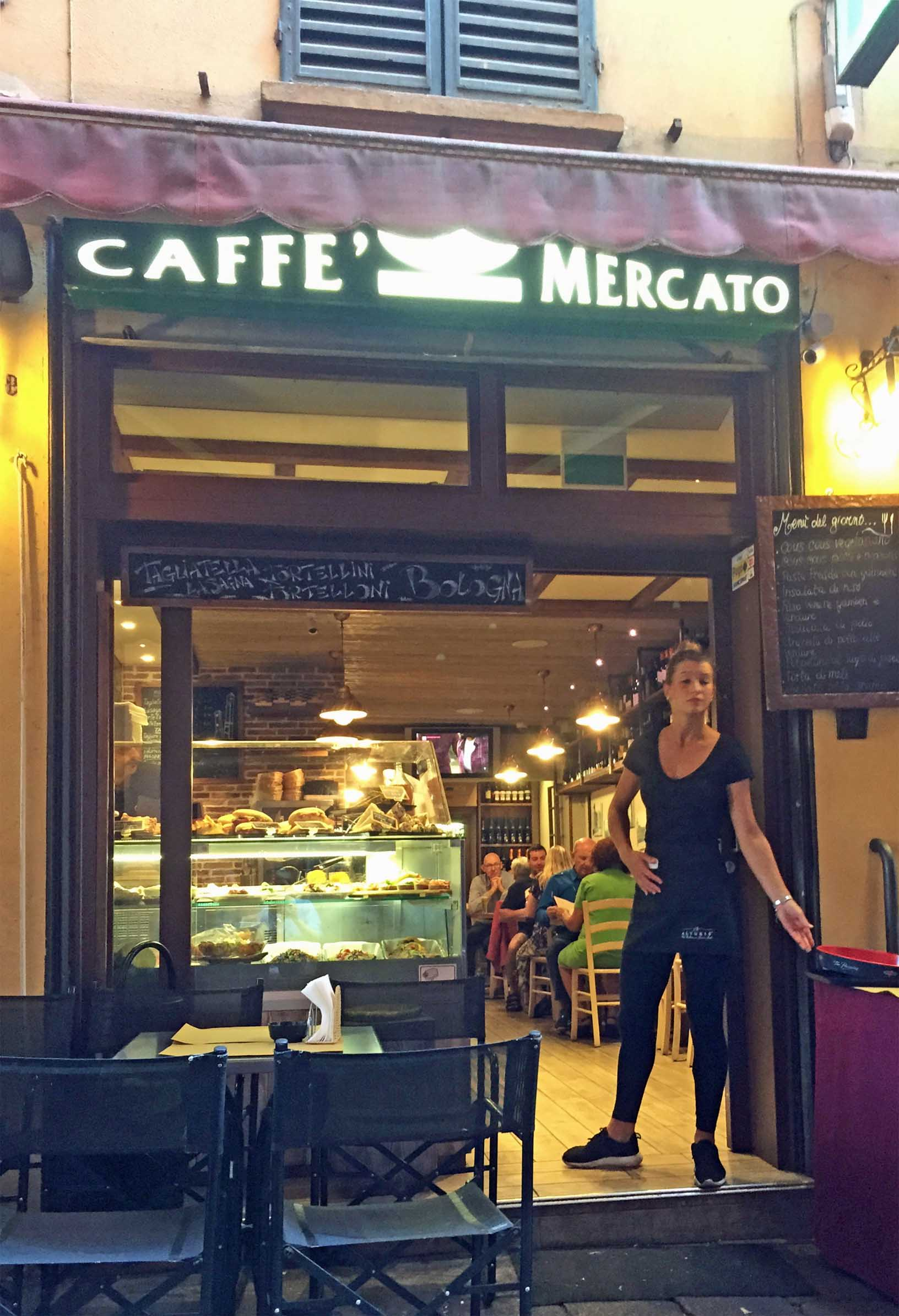 Small cafe with waitress in the doorway