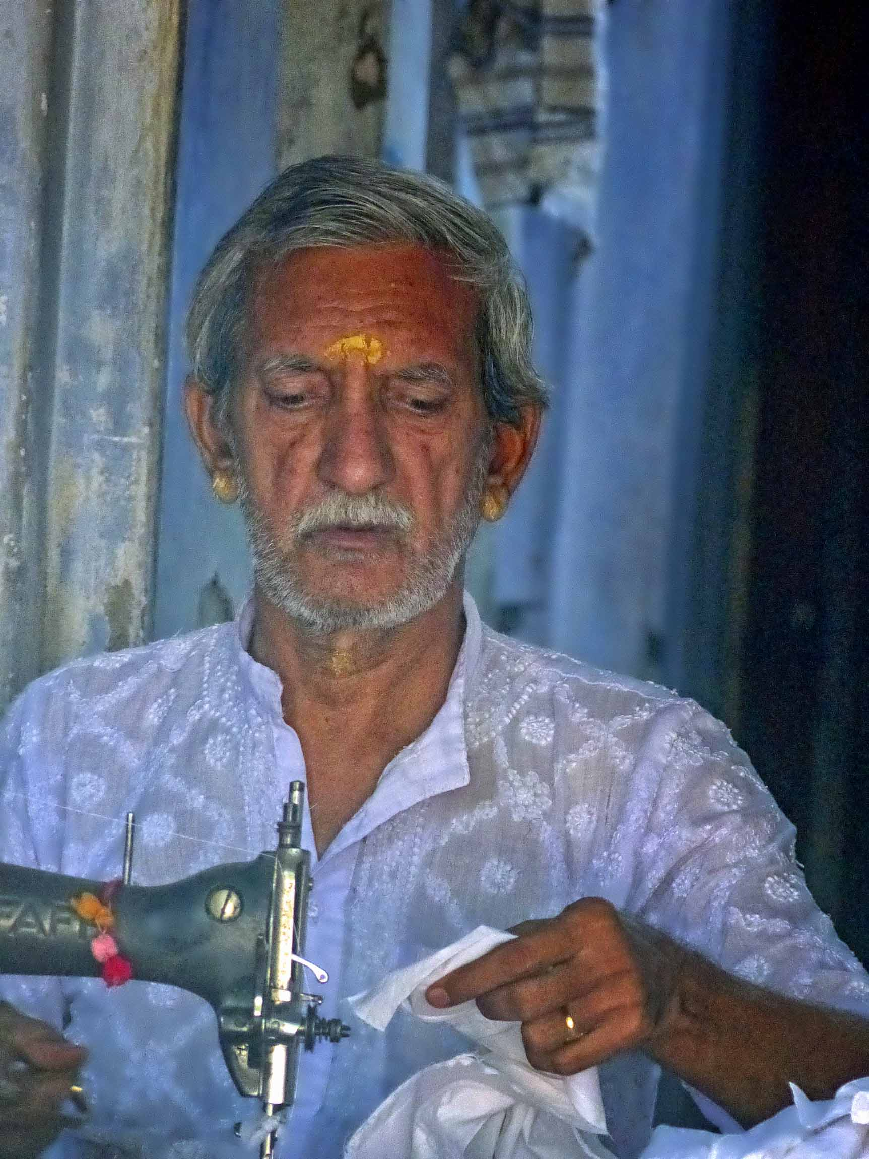 Man at an old-fashioned sewing machine