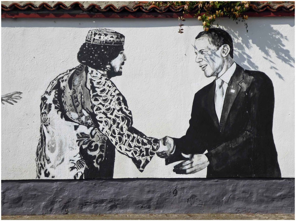 Mural of Barack Obama shaking hands with another man