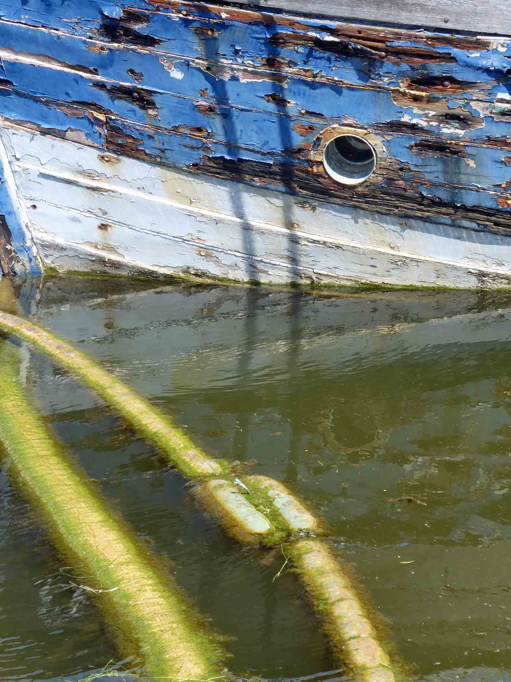 Flaking blue paint on a boat