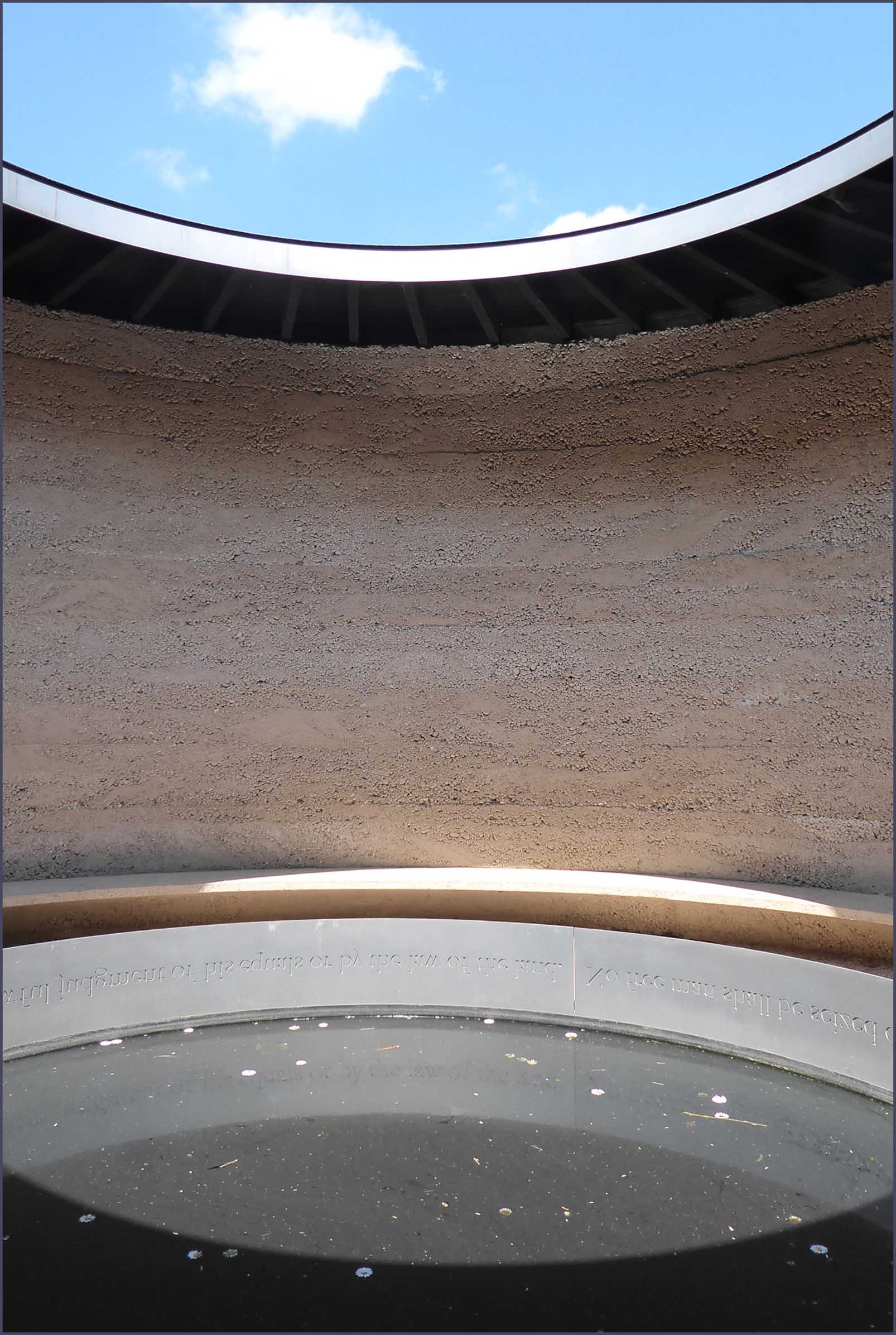 Curved wall with sky above