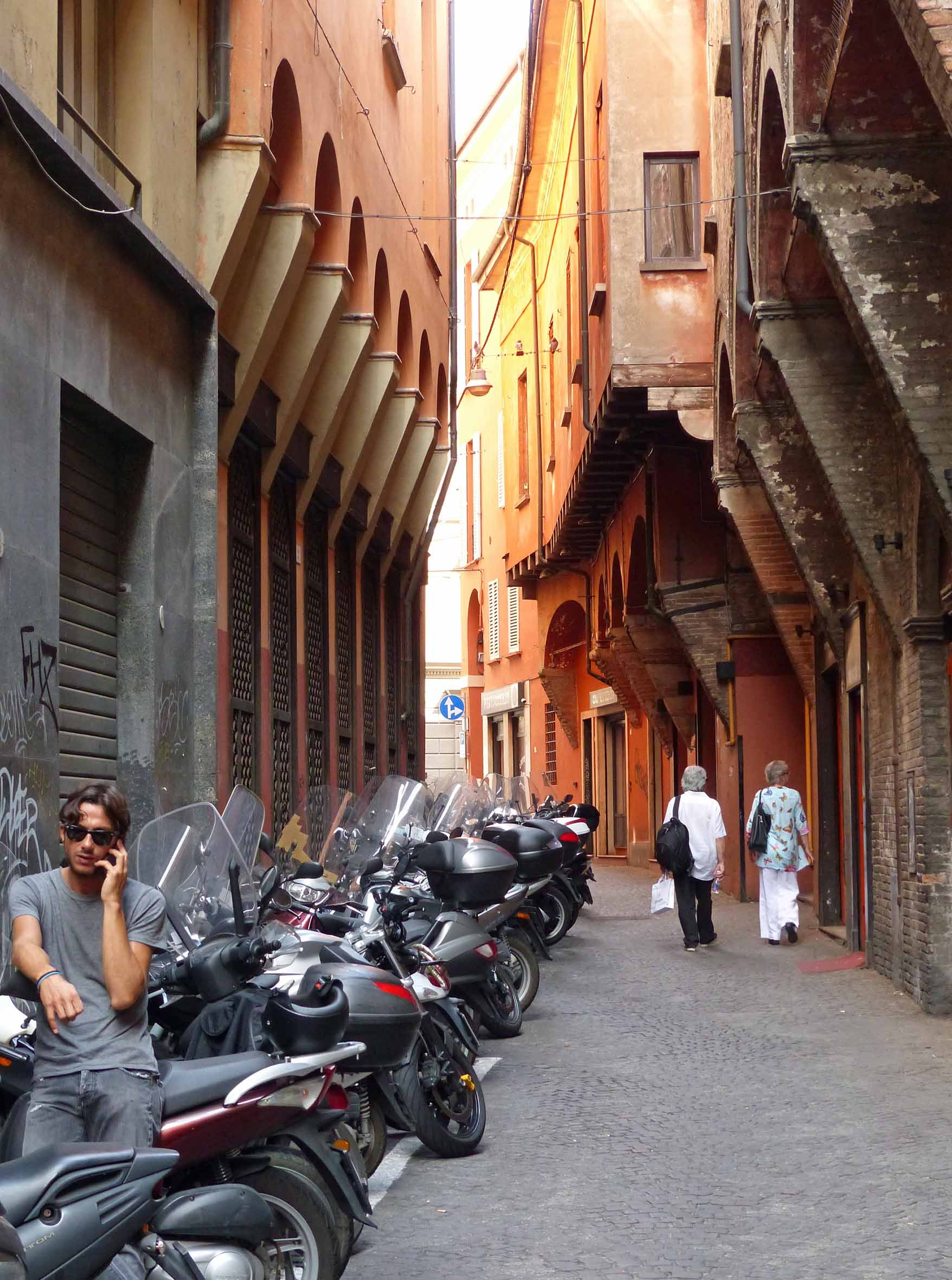 Narrow street with parked mopeds