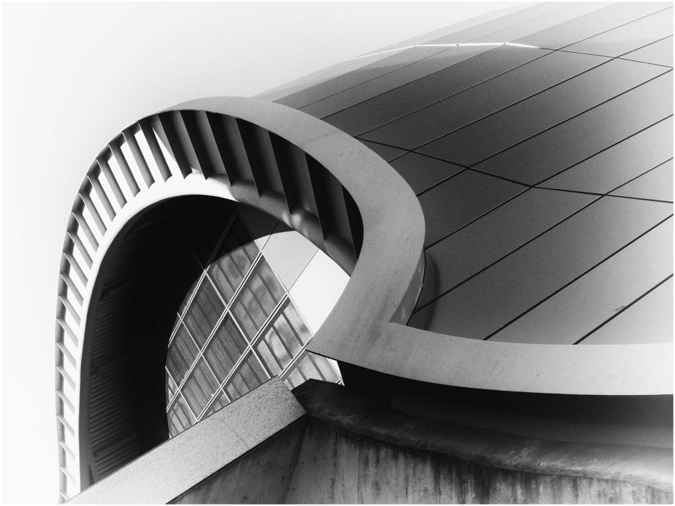 Curved modern building in glass and metal
