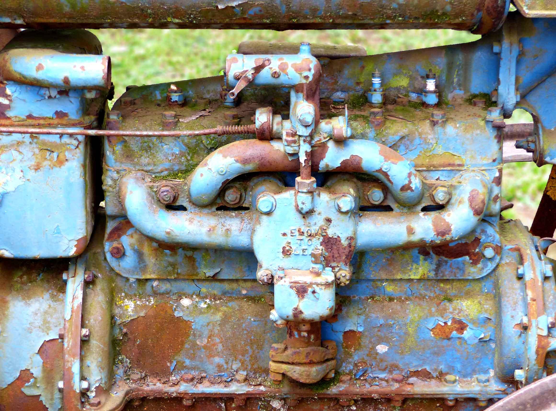 Peeling blue paint and rust