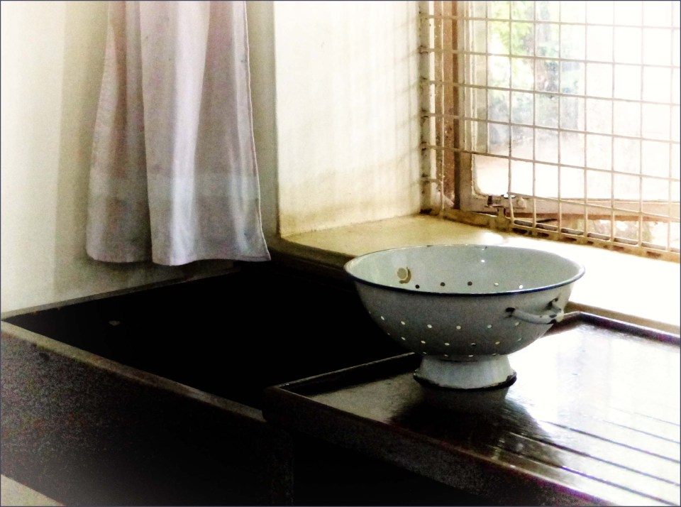 Old fashioned colander and sink