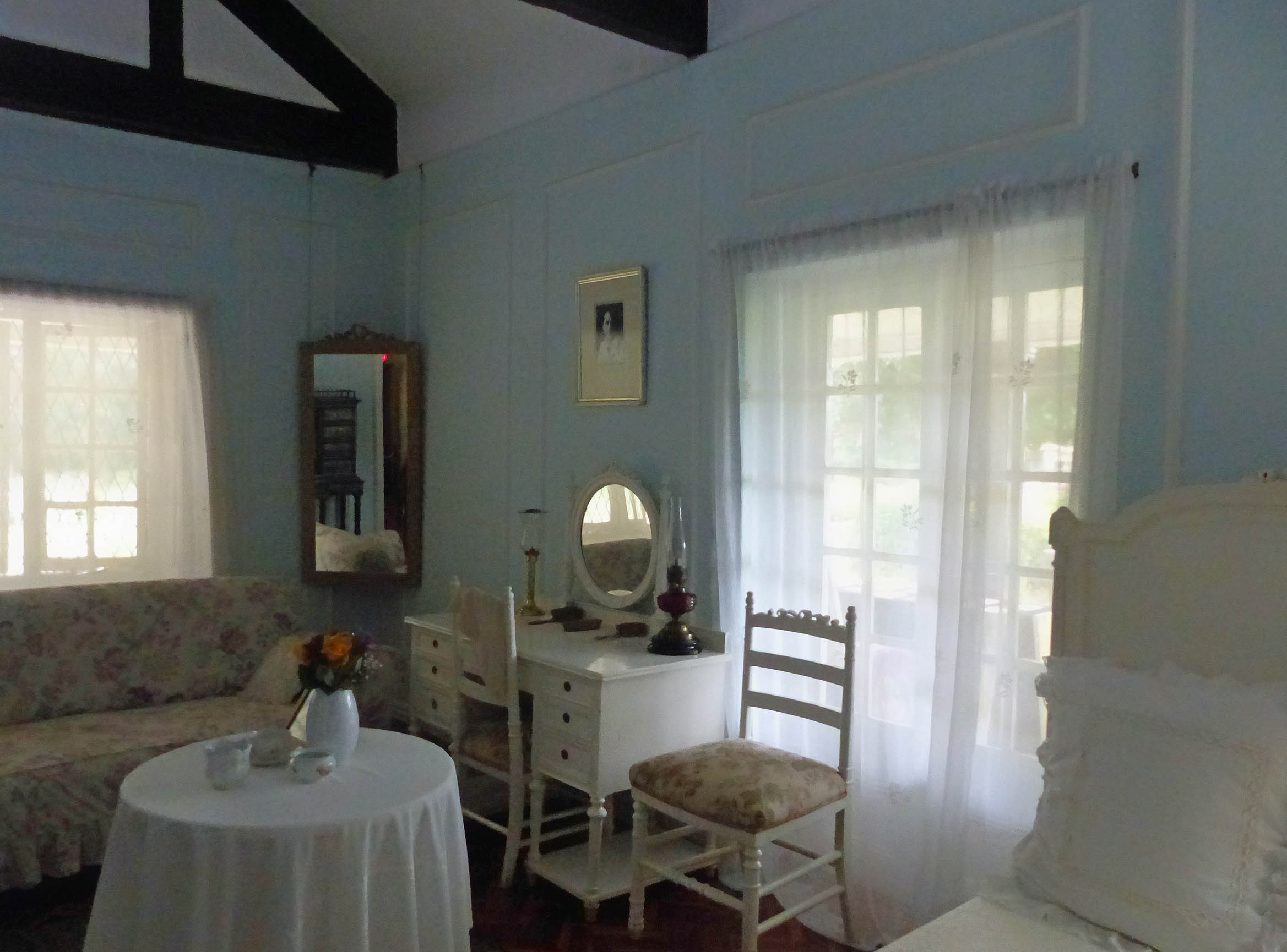 Old fashioned bedroom painted pale blue
